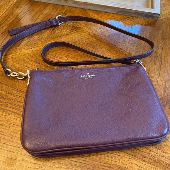 kate spade Handbags - EUC Kate Spade cross body bag. Plum colored.